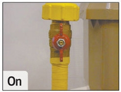 Image showing a natural gas meter level in the on position with the tap fins running vertically