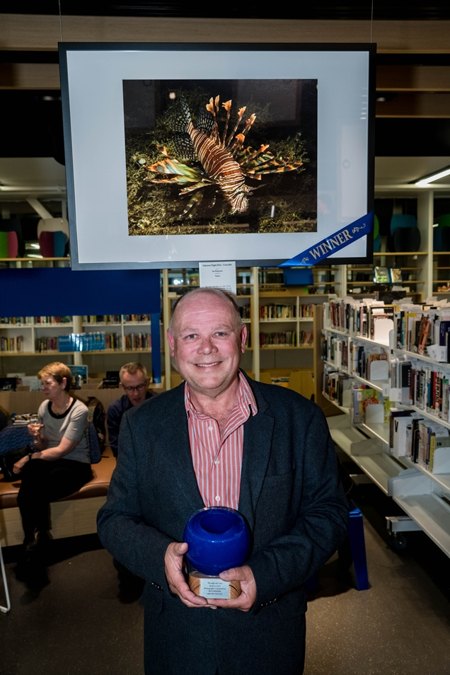 Ian Patterson pictured with his winning photograph and holding his award