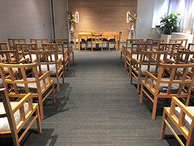 CBS marriage room view from the back with tables and chairs