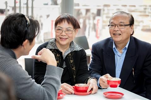 Senior Asian couple receiving translating assistance