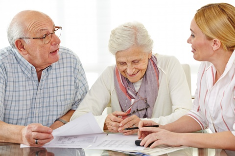 Senior couple receiving financial advice
